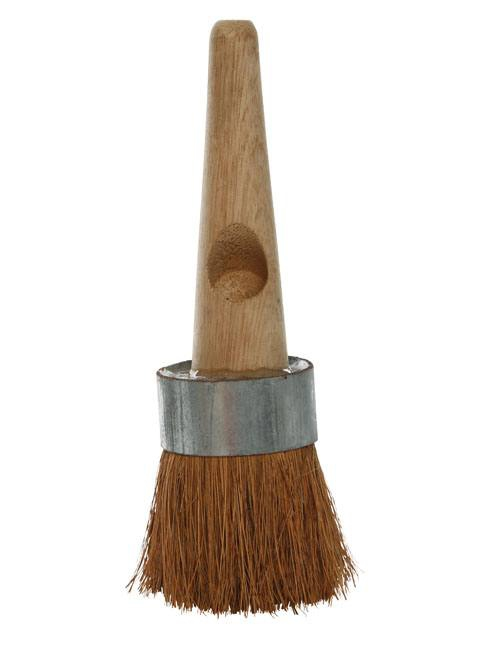 Tar brush with round head with tough, dark brown coco bristles and a very short wooden handle