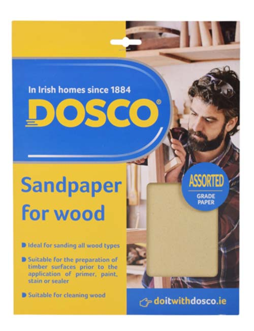 Sheets of beige cabinet glass sandpaper in Dosco packaging depicting a man sanding a wooden chair