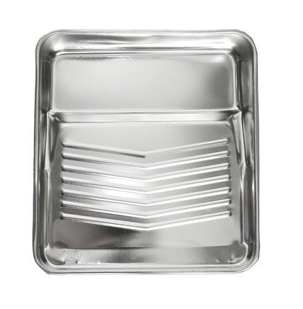 A shiny metal paint tray with a ridged surface